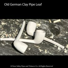 clay pipe with leaf design