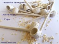 Set of six new clay pipes